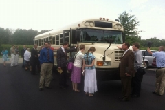 Praying over the church bus
